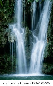 Waterfall flowing on rock in woods in long exposure