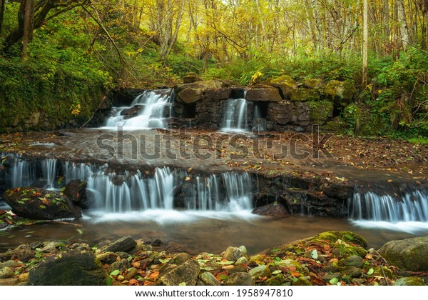 waterfall-flowing-through-rocks-deep-600