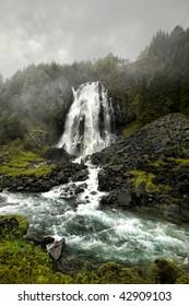 """Waterfall in fog"""