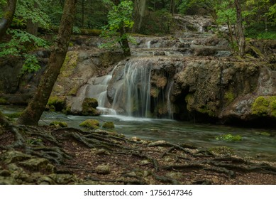 Waterfall in the forest. Carpathian Mountains. Clean water. Mossy rocks. La Vaioaga, Banat, Romania.