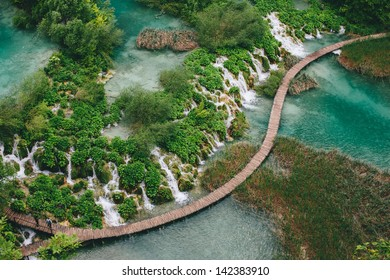 Waterfall in forest. Crystal clear water. wooden walk path, Plitvice lakes, Croatia