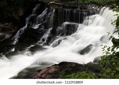 A waterfall in a forest.  Old Stone Fort State Archaeological Park, Manchester, TN, USA.