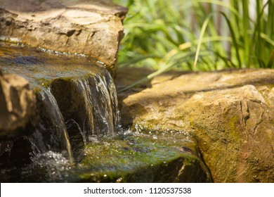 Waterfall in forest. Photo of nice small waterfall in sunny forest