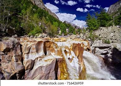 Waterfall of Ganges River flows across the Gangotri town. Uttarakhand. India.