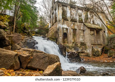 A waterfall in Gatineau Park Quebec, on Meech creek, near Meech Lake and Chelsea, thunders down beside the old ruins once owned by Thomas 'Carbide' WIllson.