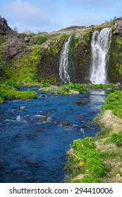 Waterfall in the Gjain gorge in Iceland