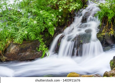 Waterfall and green vegetation on Armenteira river in the stone and water route in Meis town, Galicia, Spain