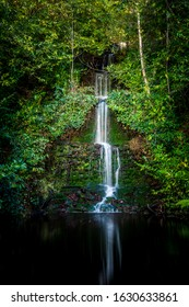 A waterfall hidden in the Surrey Hills.Surrey Hills is a 422 km2 (163 sq mi) Area of Outstanding Natural Beauty (AONB) which covers one quarter of the county of Surrey, England.