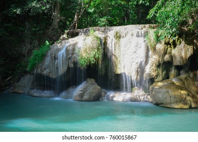 Waterfall hidden in the tropical jungle (erawan waterfall) in kanchanaburi province asia southeast asia Thailand