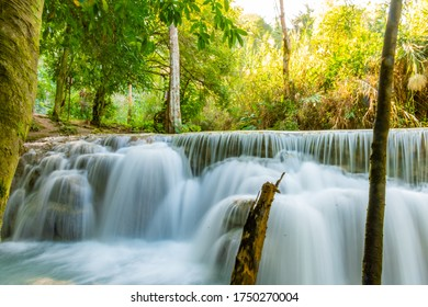 The waterfall Huay Mae Kamin is beautiful In tropical In Kanchanaburi Thailand. decoration image contain​ certain​ grain​ noise and​ soft​ focus.