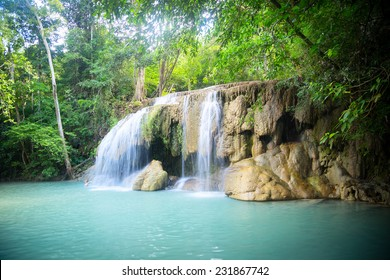 Waterfall in the jungle. Green lake.