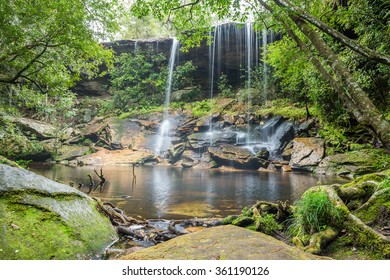 Waterfall in jungle with stone