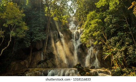 Waterfall Kuang Si in Laos with light streaks, fog and nevel