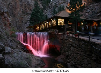 Waterfall and lodge at Seven Falls Park in Colorado Springs. At night, these falls are illuminated with several different colors in series.