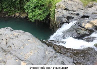 waterfall lombok bali at tiue tibu in indonesia jungel