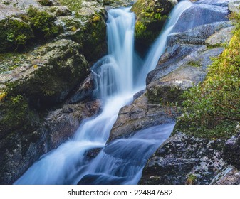 Waterfall and mossy rocks in Yakushima, Japan