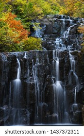 Waterfall in the mountain of Akita Prefecture, Japan with Autumn colors