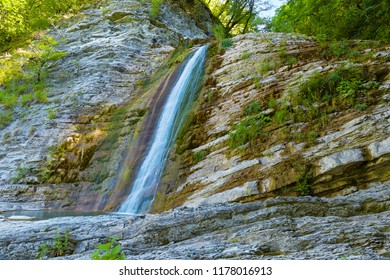 Waterfall in mountain of Caucasus. Summer landscape with waterfall and water stream on forest of Caucasus mountain.