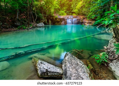 Waterfall in mountain forest. Nature composition