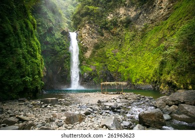 Waterfall in a mountain gorge, Philippines.
