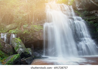 Waterfall mountain landscape select focus with fair light, Waterfall in mountain forest Blurred or blurry soft focus