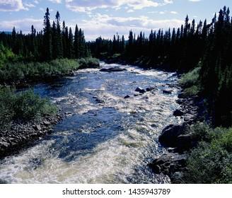 Waterfall in mountains (Yukon River in Yukon, Canada)