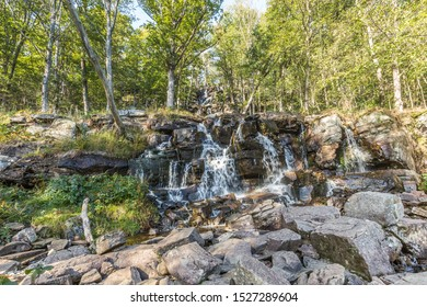 Ramhultavägen waterfall with moving water due to slow shutter speed lies in the river Ramnån and flows out into Lake Lygnern in the Västra Götaland region near the town of Sätila in Sweden