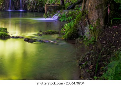 Waterfall with mystical light at sinter terraces of the Kaisinger Tal (Kaisinger Valley) at Greding (Bavaria, Germany)