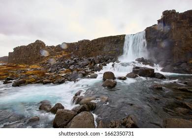 Öxarárfoss is a waterfall in Þingvellir National Park, Iceland. It flows from the river Öxará over the Almannagjá.