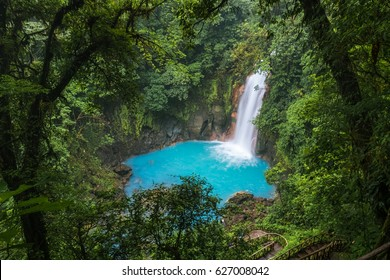 Waterfall and natural pool with turquoise water of Rio Celeste, Costa Rica