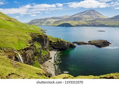Waterfall near Bour town  on coast of Faroe islands, Denmark