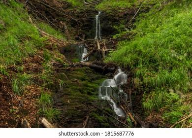 Waterfall near Kouty nad Desnou village in summer day in forest - Shutterstock ID 1815687776