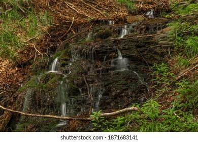 Waterfall near Kouty nad Desnou village in summer day in forest - Shutterstock ID 1871683141