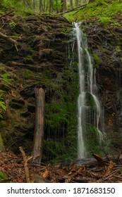 Waterfall near Kouty nad Desnou village in summer day in forest - Shutterstock ID 1871683150