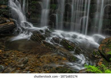 Waterfall near Kouty nad Desnou village in summer day in forest - Shutterstock ID 1871683174