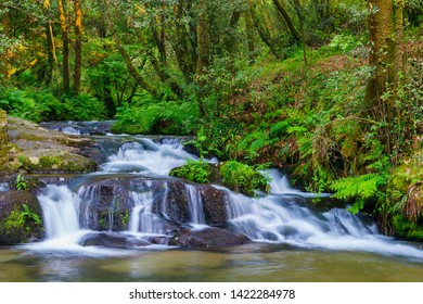 Waterfall on Amenterira river along the forest of the stone and water route in Meis town, Galicia, Spain