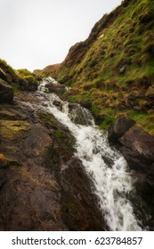 waterfall on the coast path between st ives and zennor cornwall uk.