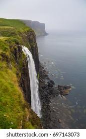 Waterfall on coastal rock of the isle of Sky, Scotland