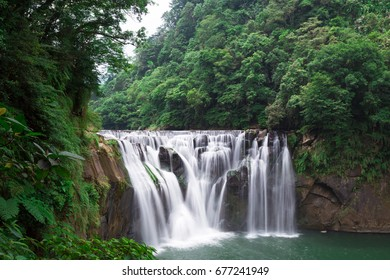 waterfall on green valley