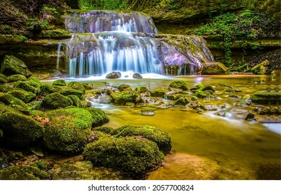 Waterfall on mossy rocks in the forest. Mossy rocks waterfall stream. Waterfall in mossy forest. Waterfall view