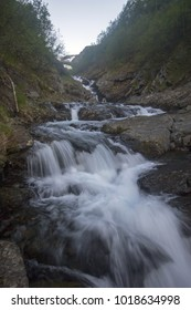 Waterfall on the mountain stream of the Subpolar Urals