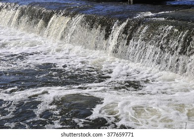 Waterfall on the river. Groyne hydraulic structure of on the river Ros. City of Bila Tserkva. Ukraine.