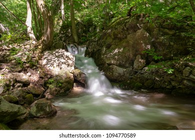 Waterfall on stream in forest in Zadiel valley in Slovakia