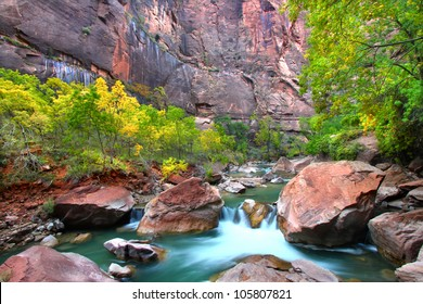 Waterfall on the Virgin River flows through large boulders in Zion Canyon