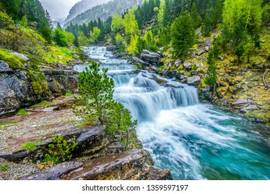 waterfall in Ordesa valley and the mountain range above it, , Ordessa and Monte Pertdido National Park, Huesca Pyrenees, Aragon, Spain