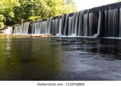 A waterfall over a dam.  Old Stone Fort State Archaeological Park, Manchester, TN, USA.