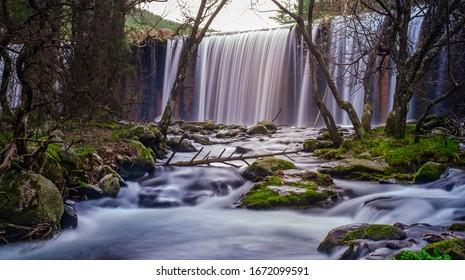 waterfall over river in madrid spain, rascafria