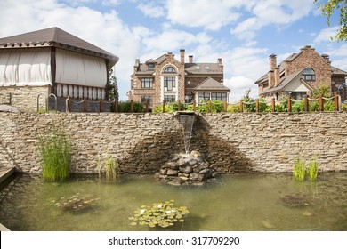 Waterfall and pond in the Park, suburbs of Moscow