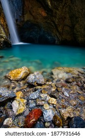 waterfall pool and colored stone around