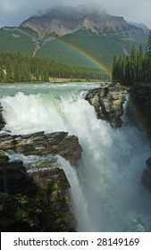 Waterfall with rainbow in Jasper National Park Canadian Rockies